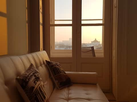 sunny flat with view and hand sanitizer