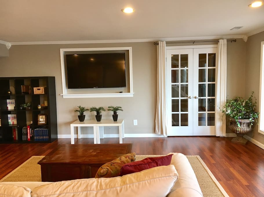 """Living room with 60"""" Smart TV"""