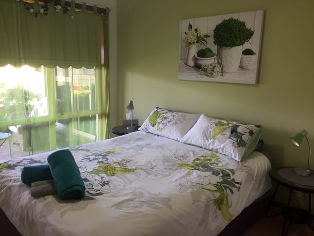 This bedroom has a ceiling fan and faces north towards the paddocks.