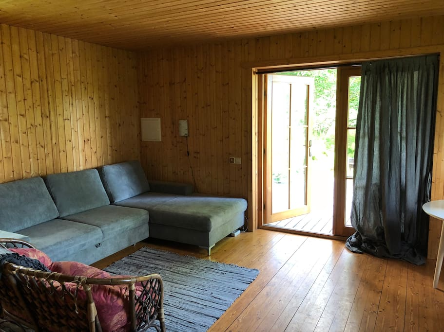 The 1st floor. Couch that is used also for sleeping. This is where all the hanging out takes place in case of not nice weather :)