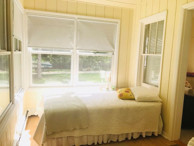 Twin bed in the sunroom