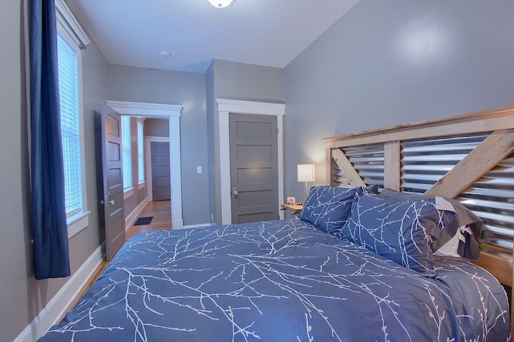 Bedroom 1 has custom owner built bed frame and matching night stands.  Outlets in lamps for easy tech charging.  Black out curtains.  Office with twin bed connected to this bedroom.