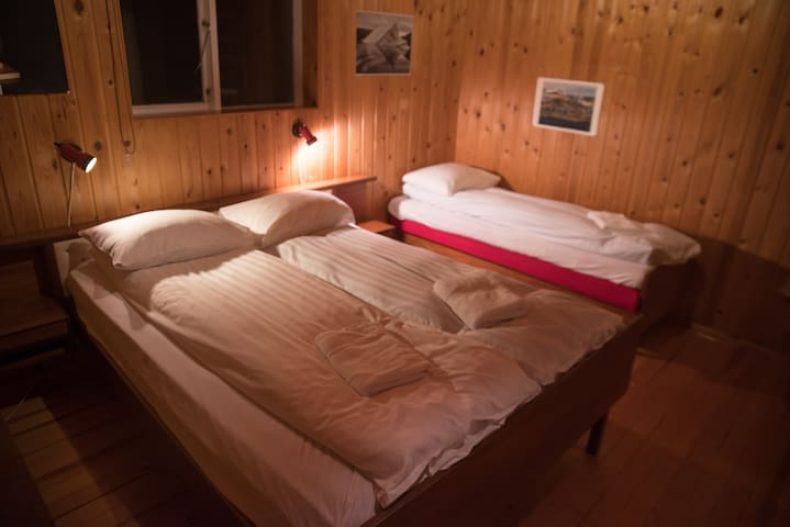 The largest bedroom, with double and single bed and can accommodate an extra bed if required