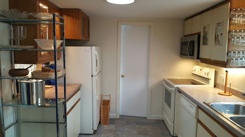 Efficient, equipped kitchen. Tub/shower bathroom through door with stacking w/d