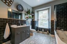 Large modern bathroom. Shampoo, conditioner, body wash and soap included.