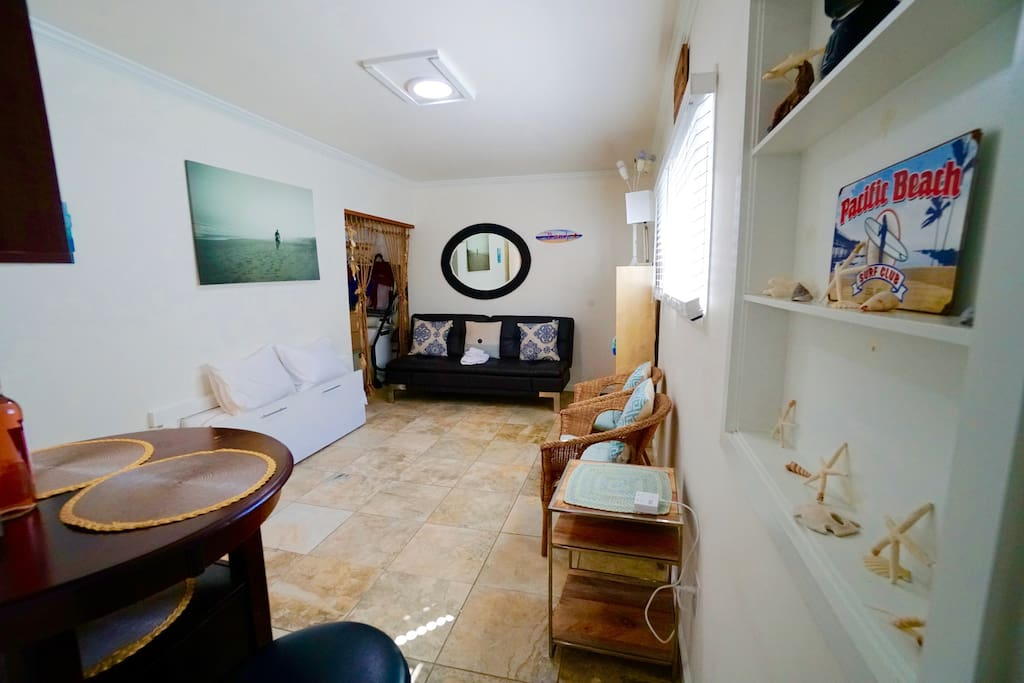 Welcome to your little beach retreat! Futon couch, chairs, dining table, large TV