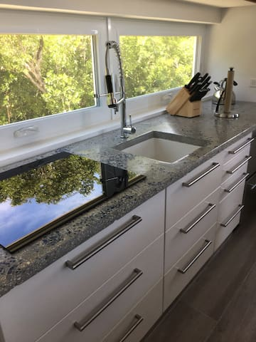 Custom made concrete counter tops embedded with sea glass