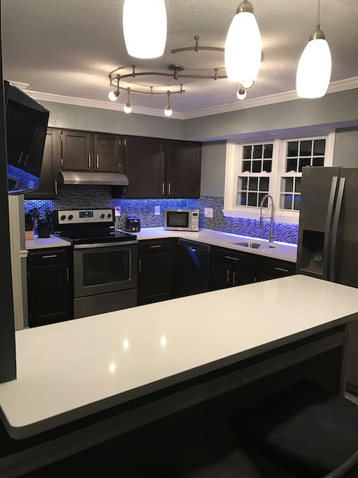 Quartz counter tops with wall mounted tv for your viewing pleasure and Sonos play 1 that allows you to stream music  just ask Alexa to play any specific type of genre of music !