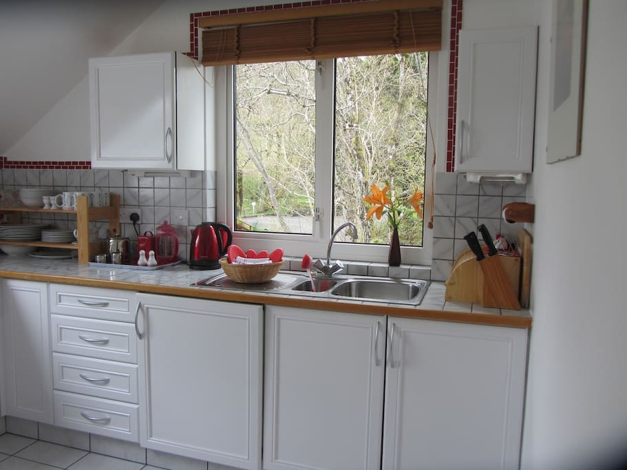 Kitchen , fridge , freezer, towels and cleaning material. All the plates and glasses you need .