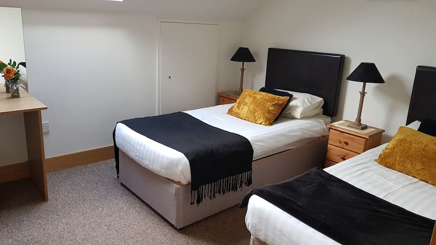 First Floor shared Ensuite Bedroom with two  Single beds