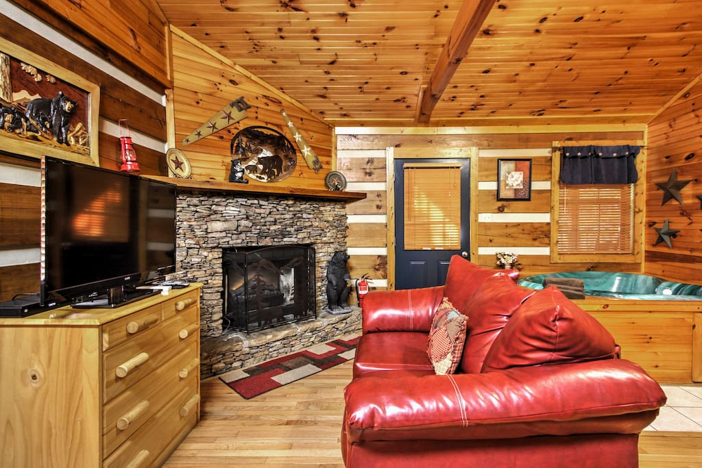 Have a movie night in the living area, complete with a comfy couch, flat-screen cable TV, DVD player and electric fireplace.