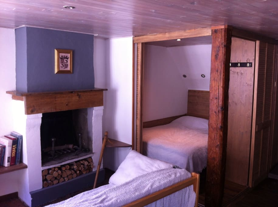 double bed with wood sliding doors opened