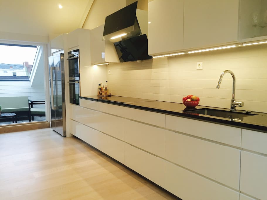 An open plan kitchen with everything you need to make a great meal. Access to terrace