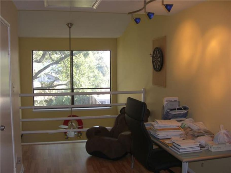 Loft area with massage chair and office space