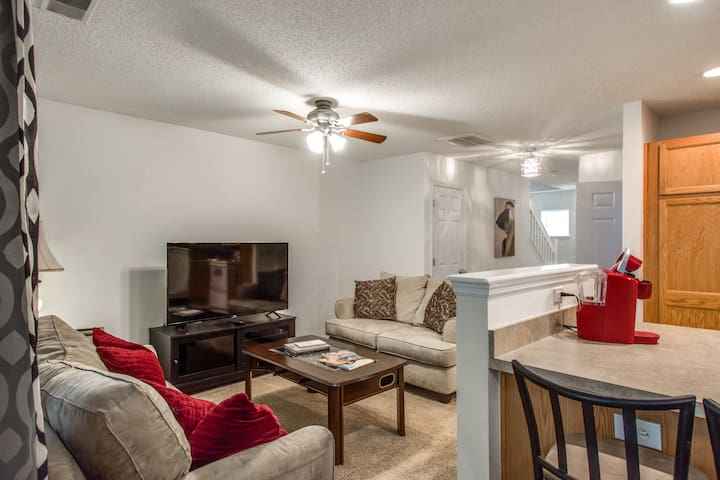 """Open living room to kitchen with foosball coffee table and 55"""" Roku TV with premium channels"""