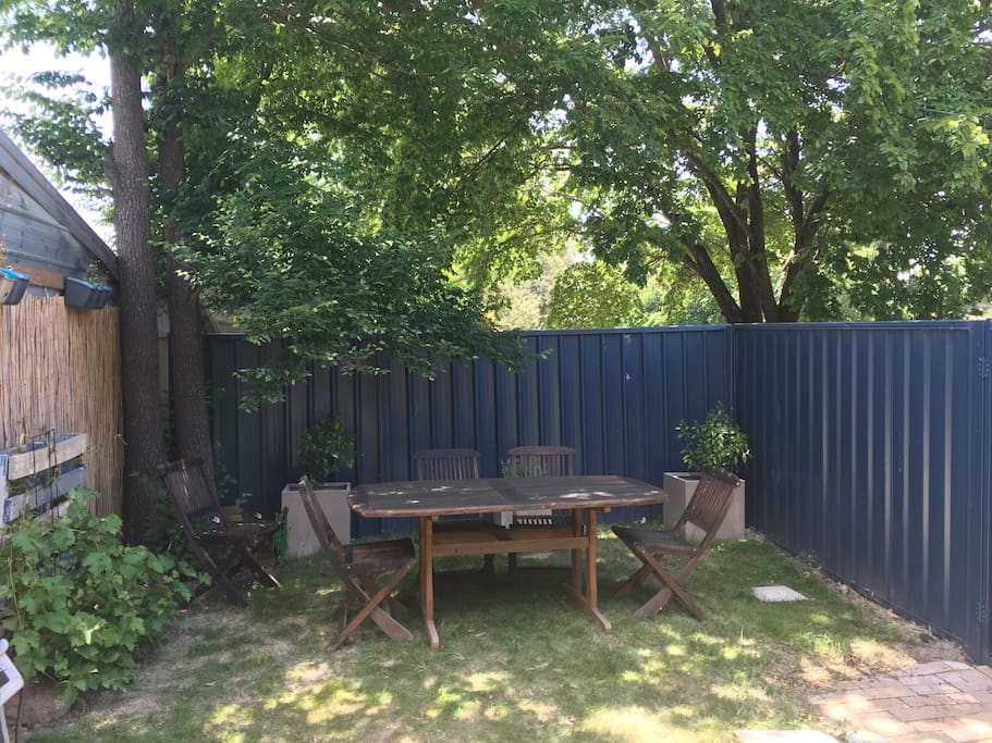 Outdoor living with rear access to bike track and public transport.