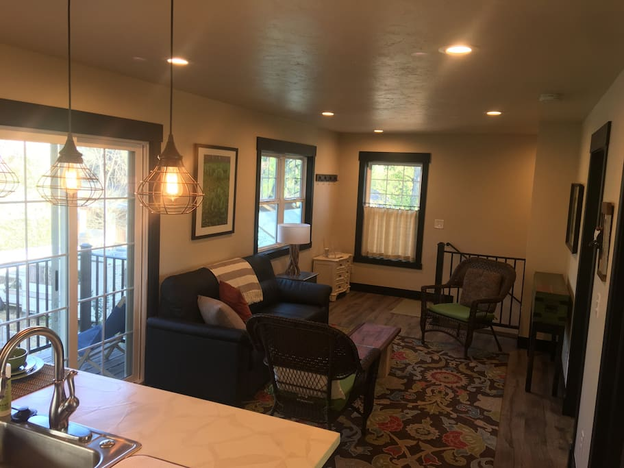 Walk up the stairs through a private entrance to the cozy living room complete with mountain views and access to a small deck. We've furnished it so you can settle in after a long day exploring, or use it as a nice place to get work done.