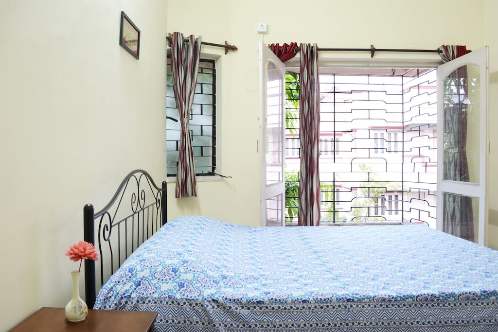 Bright, airy bedroom with  adjoining exclusive balcony
