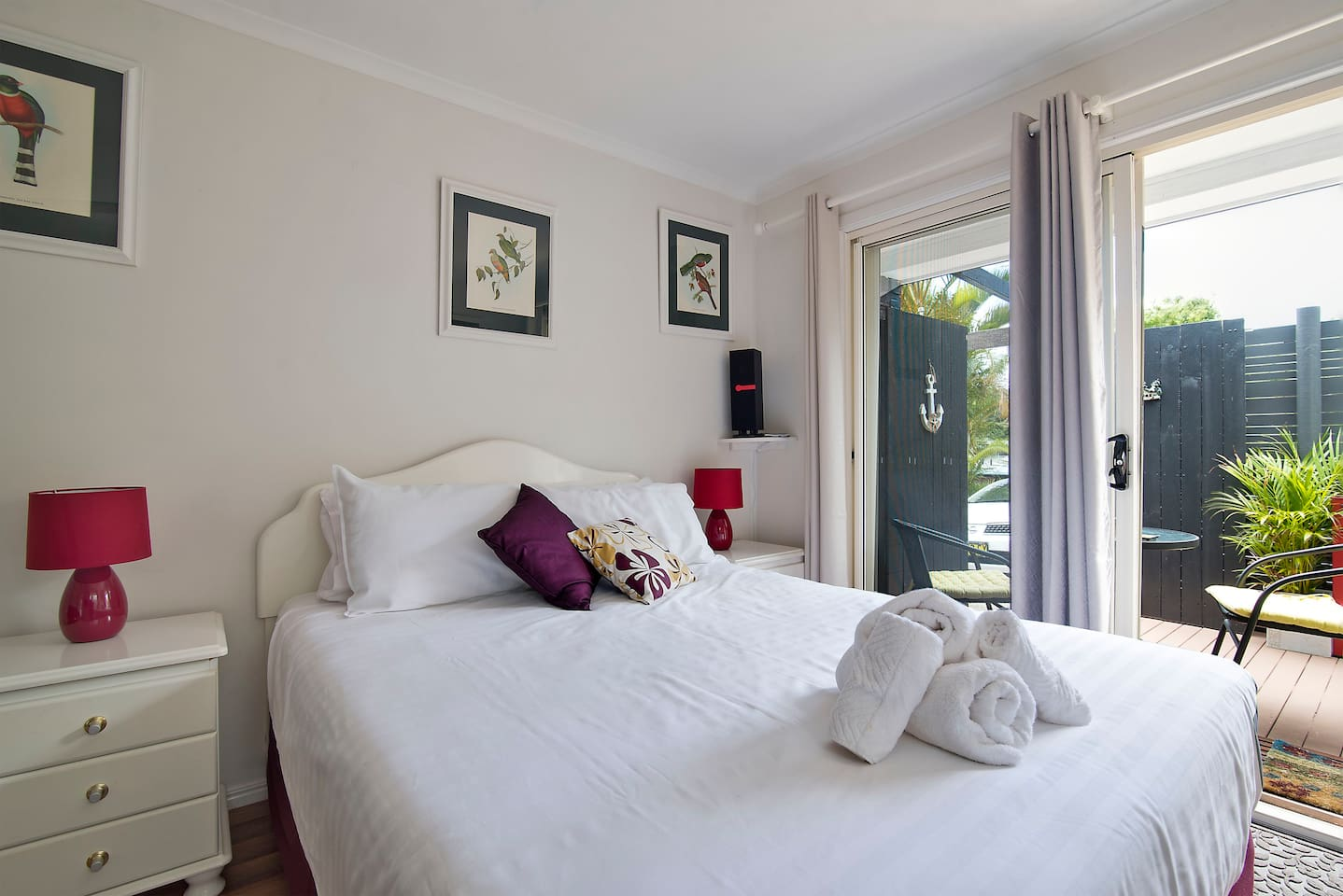 Queen Bed with a  view onto the deck and garden. Fully self contained apartment.