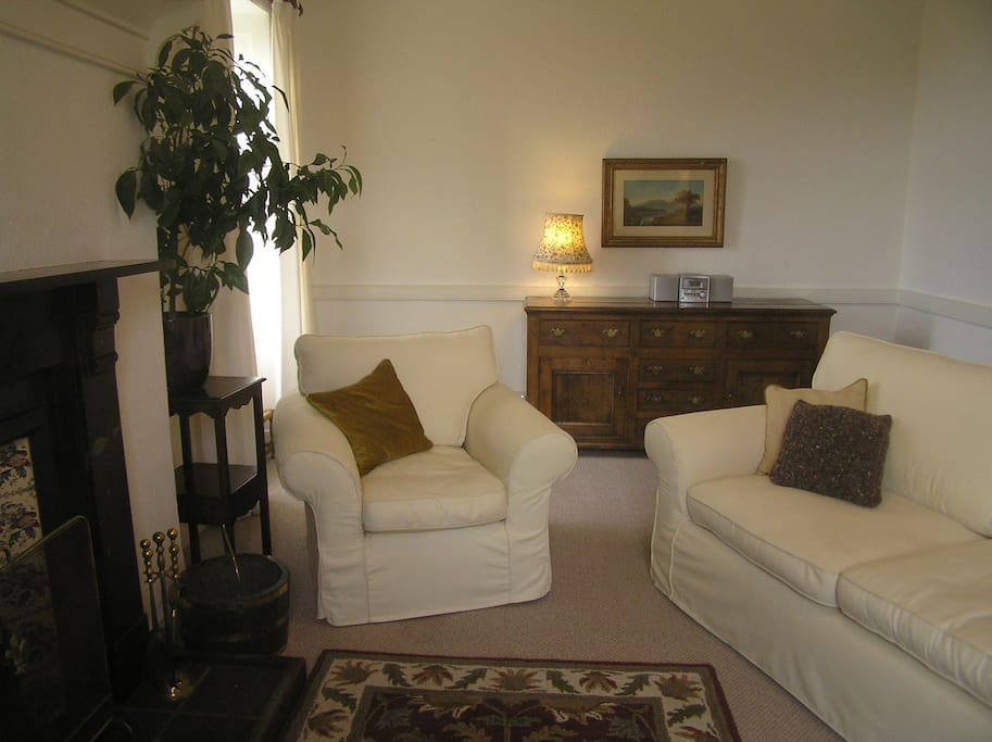 Front Wing - sitting room with open coal fire and sea views