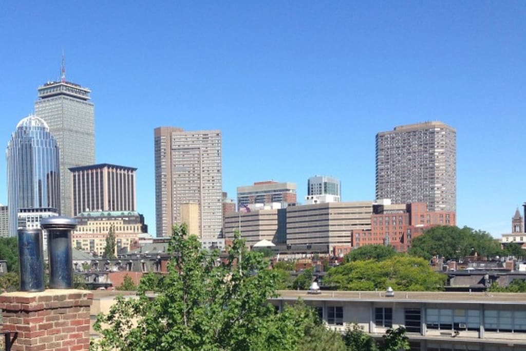 Enjoy unobstructed views of the Boston skyline from our huge private roof-deck.