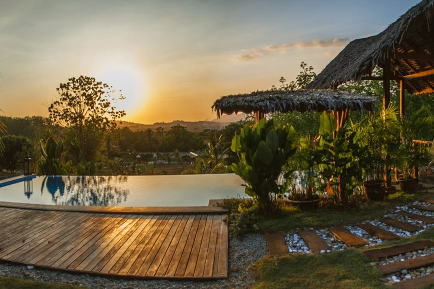 Garden and pool at sunset