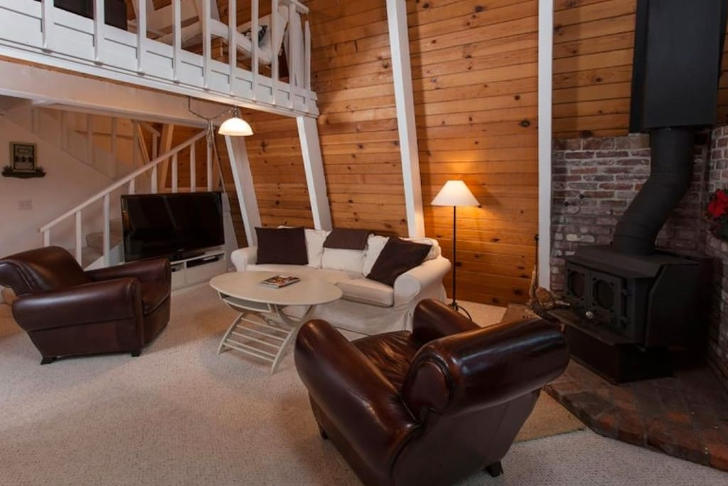 Lofted ceilings make the space feel large...woodstove and comfy leather seats.