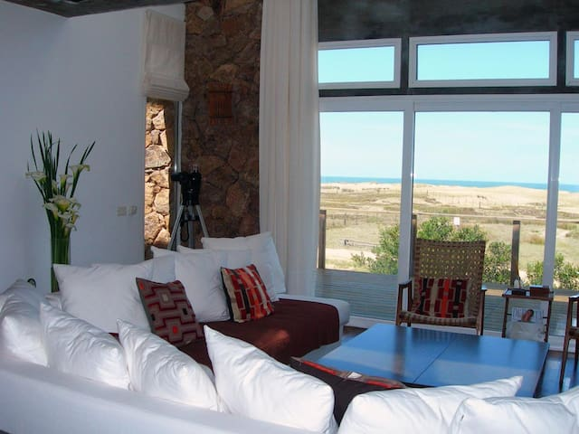Livingroom with dunes & sea view
