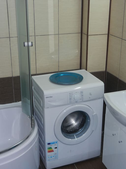 Bathroom with washing machine.