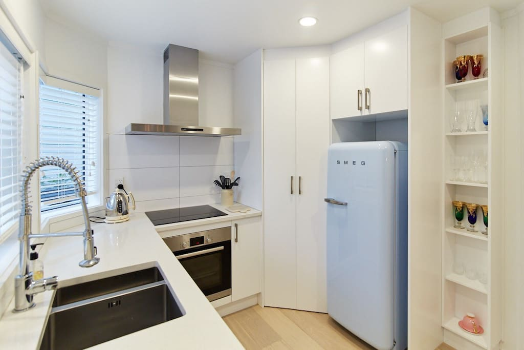 Large fridge freezer in adjoining lock up garage