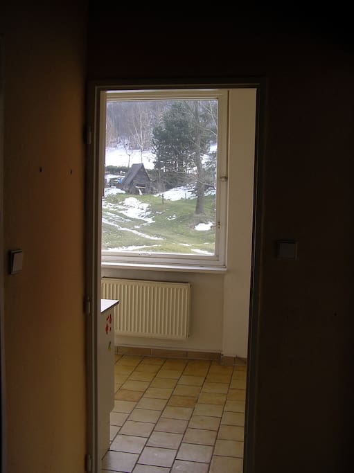 View from the hallway to the kitchen and thru the window