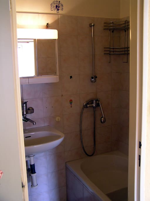 The bathroom has hot water, shower and a bathtub.