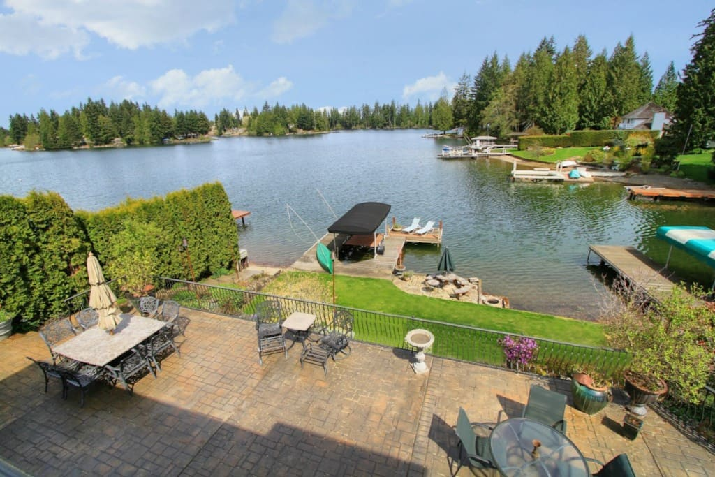 Large patio, dock, and swim area. Lake levels in summer/fall. This is a protected cove - the open lake is beyond the  wooded island.