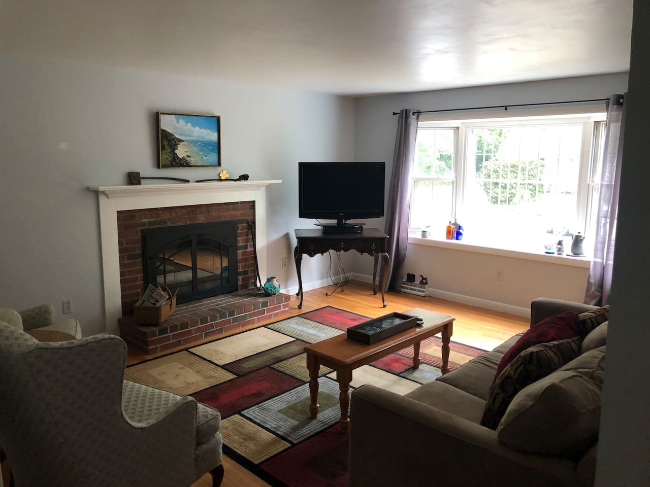 Livingroom with cozy woodburning fireplace. TV with cable.