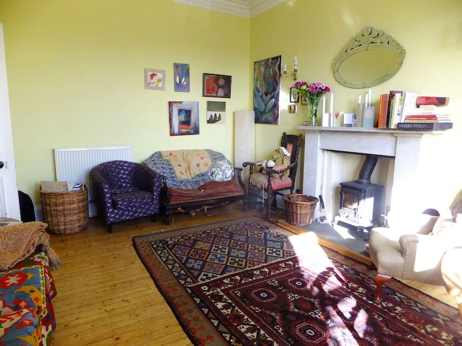Sitting room with a wood burning stove for cozy nights in.