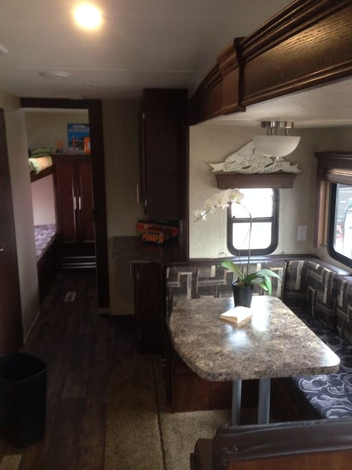 large kitchen/ dining area next to the bunk bedroom