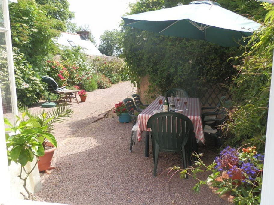 Outdoor terrace and walled south-facing garden. With former garden furniture.