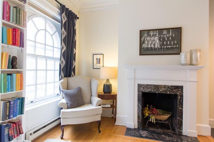 Original fireplace and wood floors