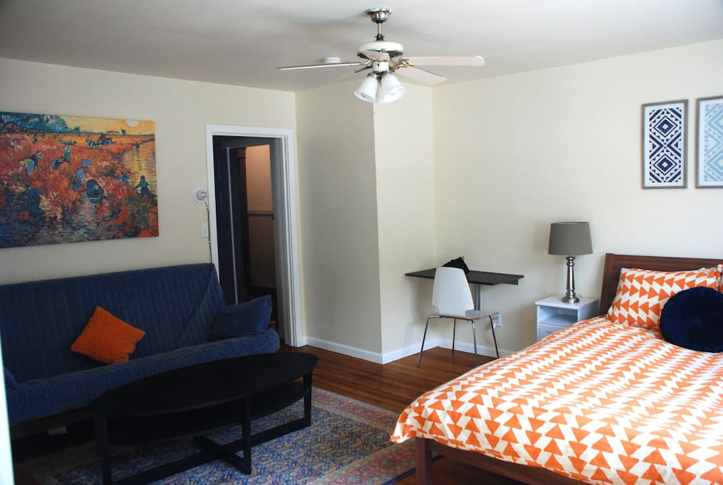 View of queen bed and futon
