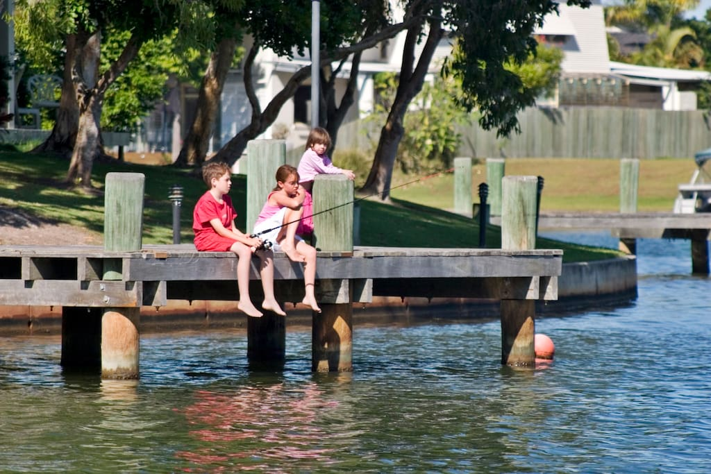 Children fishing from one of the private jetties