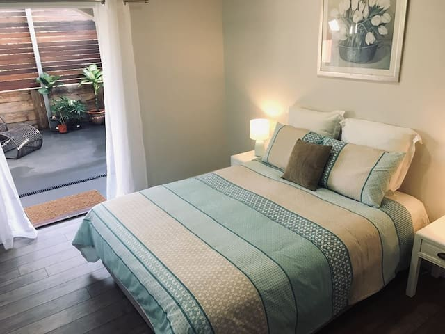 Master bedroom with queen bed, double size ensuite with bath, private courtyard