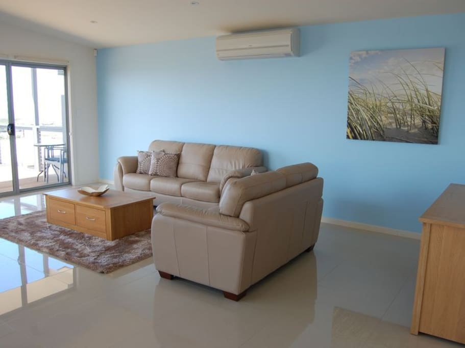 Comfortable leather lounge with TV, Blue-Ray, R/C Air Conditioning.