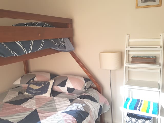Double and single beds, bedside lamp and power access. Block-out blinds for the late risers and privacy.
