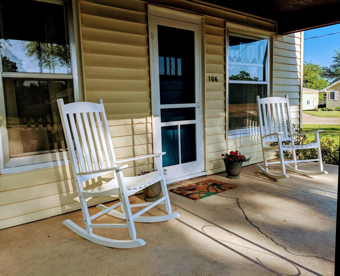 Front porch with comfortable rockers. Perfect for morning coffee or enjoying the sunset with a glass of wine.