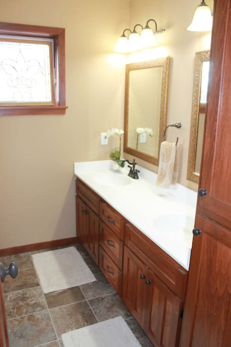 Guest Full Bathroom.  Tub, Shower & Toilet private door.