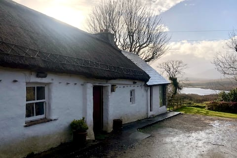 Private Thatched Cottage - with views