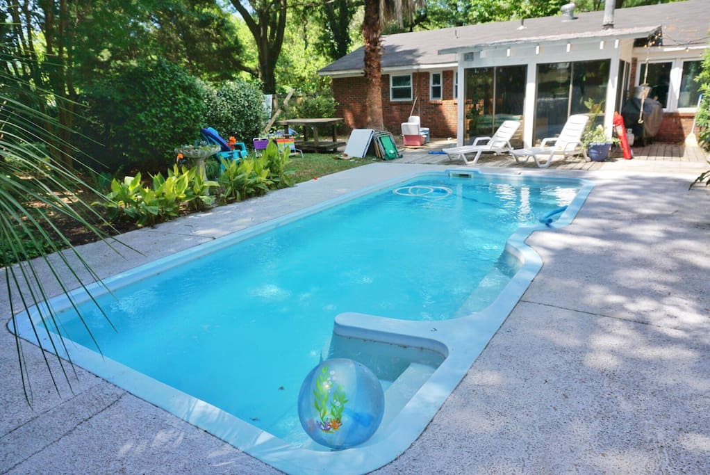 Lush tropical landscaping surrounds you as you lay by the pool.