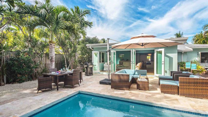 There are plenty of outdoor dining and lounging options surrounding the pool...