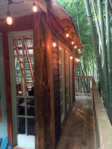East side wrap around deck of the alpaca treehouse.
