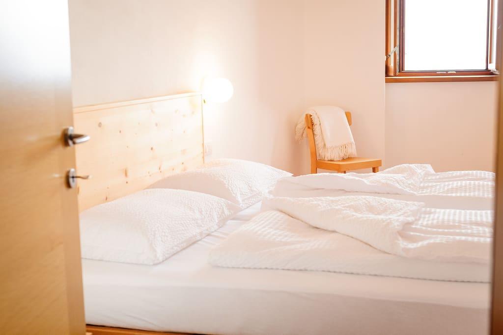 Materiali naturali come il legno e biancheria anallergica conciliano il sonno